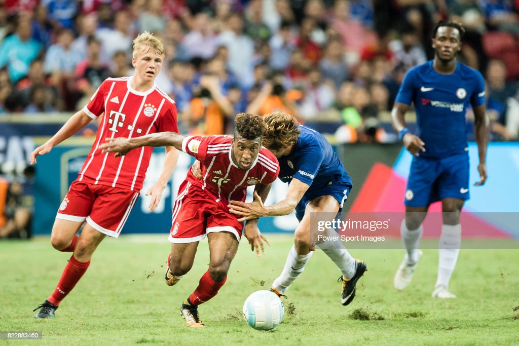 Bayern Munich Forward Kingsley Coman (C) fights for the ball with Chelsea Defender Marcos Alonso (R) during the International Champions Cup match between Chelsea FC and FC Bayern Munich at National Stadium on July 25, 2017 in Singapore.