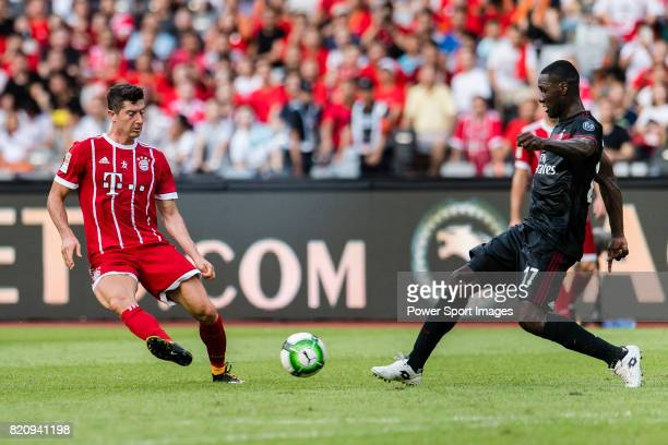 Bayern Munich Forward Robert Lewandowski fights for the ball with AC Milan Defender Cristian Zapata during the 2017 International Champions Cup China...