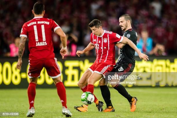 Bayern Munich Forward Robert Lewandowski fights for the ball with AC Milan Defender Leonardo Bonucci during the 2017 International Champions Cup...