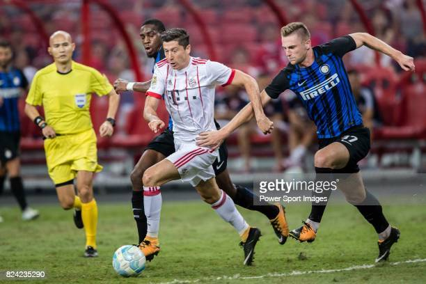 Bayern Munich Forward Robert Lewandowski fights for the ball with FC Internazionale Midfielder Geoffrey Kondogbia and FC Internazionale Defender...