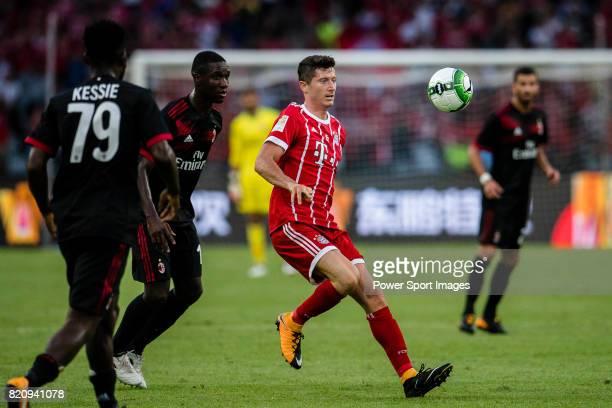 Bayern Munich Forward Robert Lewandowski in action against AC Milan Defender Cristian Zapata during the 2017 International Champions Cup China match...
