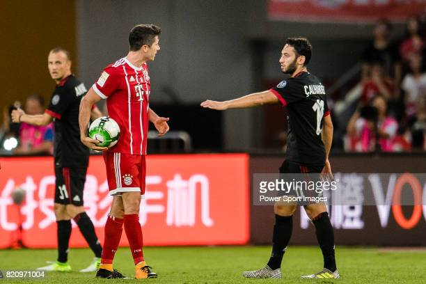 Bayern Munich Forward Robert Lewandowski reacts with AC Milan Midfielder Hakan Calhanoglu during the 2017 International Champions Cup China match...