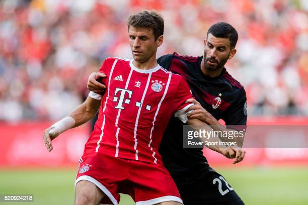 Bayern Munich Forward Thomas Muller fights for position with AC Milan Midfielder Mateo Musacchio during the 2017 International Champions Cup China...