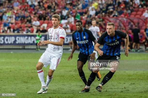 Bayern Munich Forward Thomas Muller fights for position with FC Internazionale Midfielder Geoffrey Kondogbia and FC Internazionale Defender Milan...
