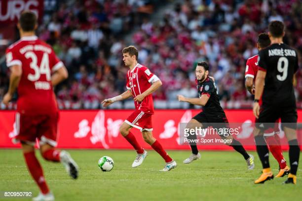 Bayern Munich Forward Thomas Muller plays against AC Milan Midfielder Hakan Calhanoglu during the 2017 International Champions Cup China match...