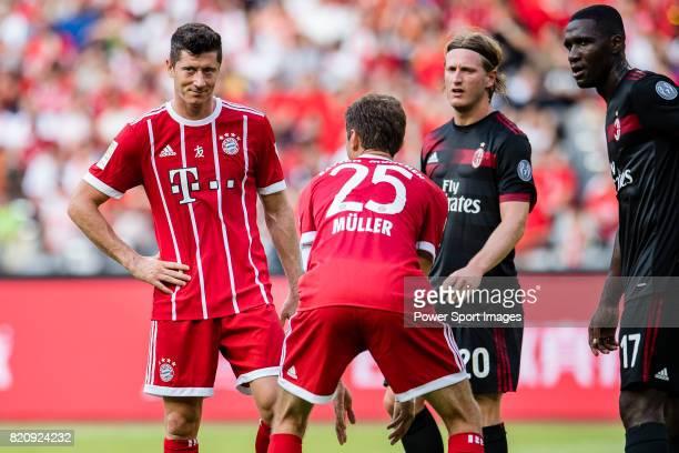 Bayern Munich Forward Thomas Muller talks to Bayern Munich Forward Robert Lewandowski during the 2017 International Champions Cup China match between...