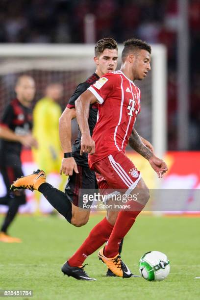Bayern Munich Midfielder Corentin Tolisso in action against AC Milan Forward Andre Silva during the 2017 International Champions Cup China match...