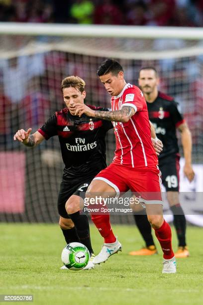 Bayern Munich Midfielder James Rodrguez fights for the ball with AC Milan Defender Lucas Biglia during the 2017 International Champions Cup China...