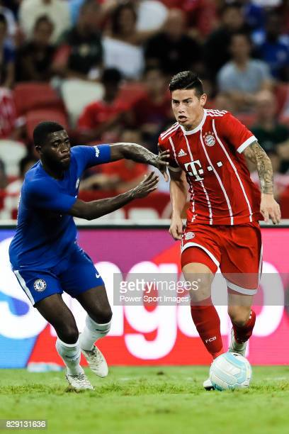 Bayern Munich Midfielder James Rodríguez in action against Chelsea Midfielder Jeremie Boga during the International Champions Cup match between...