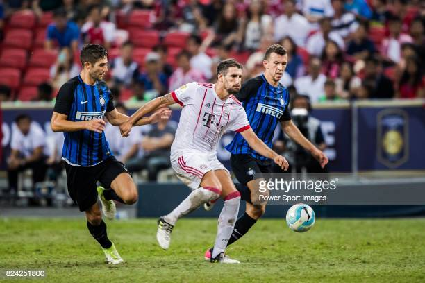 Bayern Munich Midfielder Javi Martinez fights for the ball with FC Internazionale Midfielder Roberto Gagliardini and FC Internazionale Forward Ivan...