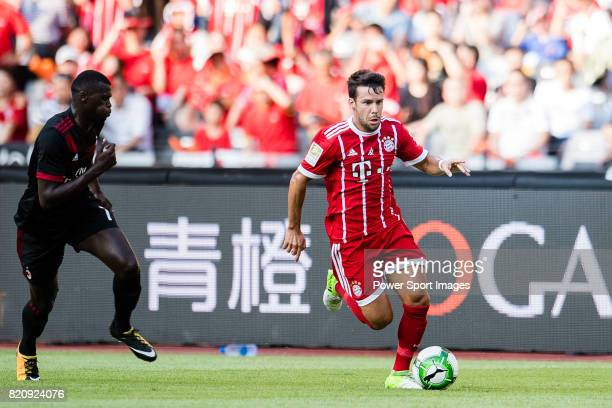 Bayern Munich Midfielder Juan Bernat in action against AC Milan Forward MBaye Niang during the 2017 International Champions Cup China match between...