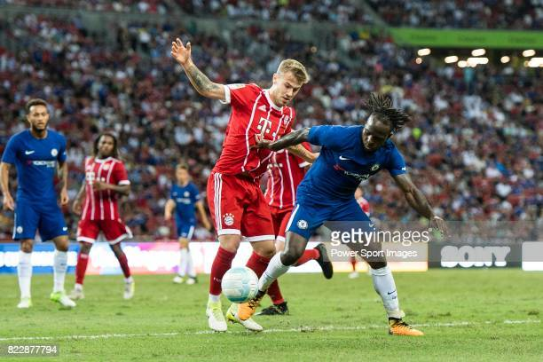 Bayern Munich Midfielder Niklas Dorsch fights for the ball with Chelsea Midfielder Victor Moses during the International Champions Cup match between...
