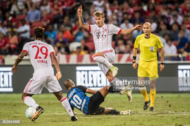 Bayern Munich Midfielder Niklas Dorsch trips up with FC Internazionale Midfielder Joao Mario during the International Champions Cup match between FC...