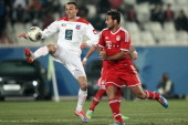 FC Bayern Munich player Claudio Pizzaro fights for the ball against alKuwait SC player Shadi alHamami during their friendly football match in Kuwait...