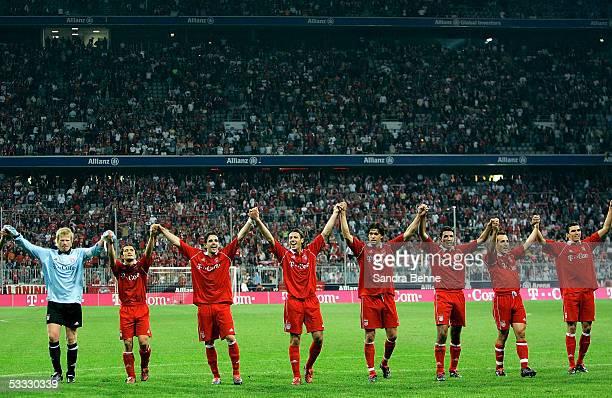 Bayern Munich players celebrate after winning the Bundesliga match against Borussia Monchengladbach at the Allianz Arena on August 5 2005 in Munich...