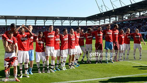 Bayern Munich players celebrate wining the league for the fourth year in a row after the German first division Bundesliga football match between FC...