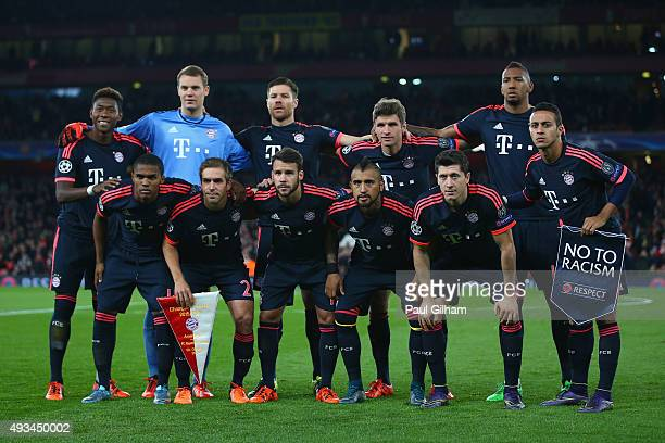 Bayern Munich players line up with a 'No To Racism' pennant prior to the UEFA Champions League Group F match between Arsenal FC and FC Bayern Munchen...