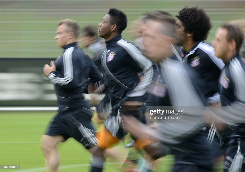 Bayern Munich players run during the final team training ahead the UEFA Champions League semi final first leg football match between FC Bayern Munich and FC Barcelona at the trainings area in Munich, southern Germany, on April 22, 2013. The semi final match will take place on Tuesday evening, April 23, 2013.