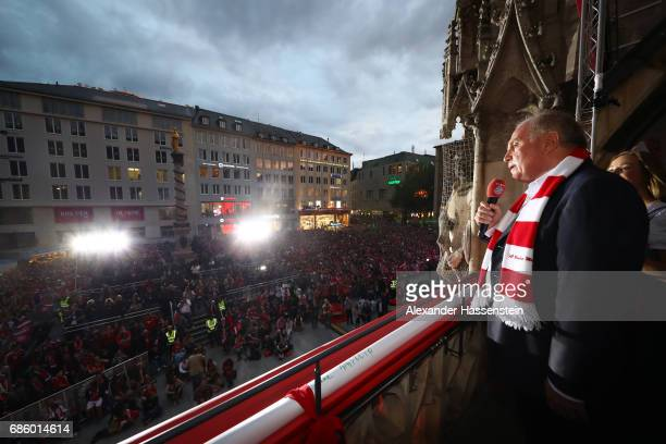 Bayern Munich president Uli Hoeness speaks to the fans as they celebrate winning the 67th German Championship title on the town hall balcony at...