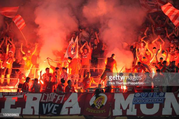 Bayern Munich spectators light red flares during the UEFA Champions League Final match between Bayern Munich and Inter Milan at the Estadio Santiago...