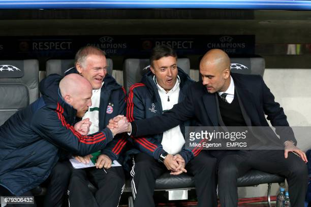 Bayern Munich sporting director Matthias Sammer shakes hands with manager Pep Guardiola before the game