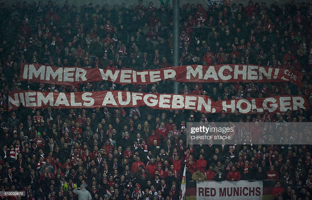 Bayern Munich supporters hold a banner for the injured Bayern Munich defender Holger Badstuber during the German first division Bundesliga football match of FC Augsburg vs FC Bayern Munich in Augsburg, southern Germany, on February 14, 2016. / AFP / CHRISTOF STACHE /