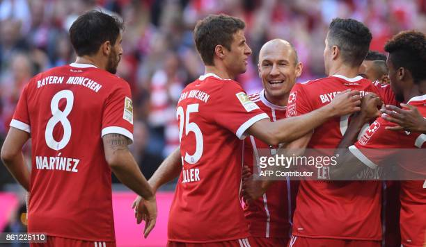 Bayern Munich teamp players celebrate after the first goal during the German First division Bundesliga football match FC Bayern Munich vs SC Freiburg...