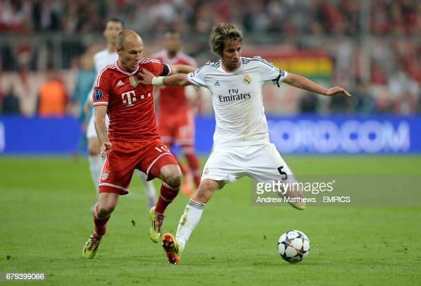 Bayern Munich's Arjen Robben and Real Madrid's Fabio Coentrao battle for the ball