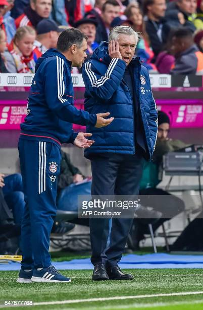 Bayern Munich's assistent coach Willy Sagnol and Bayern Munich's Italian head coach Carlo Ancelotti react at the sideline during the German First...