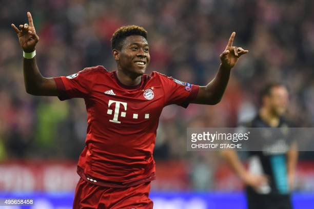 Bayern Munich's Austrian defender David Alaba celebrates after scoring the third goal during the UEFA Champions League Group F secondleg football...