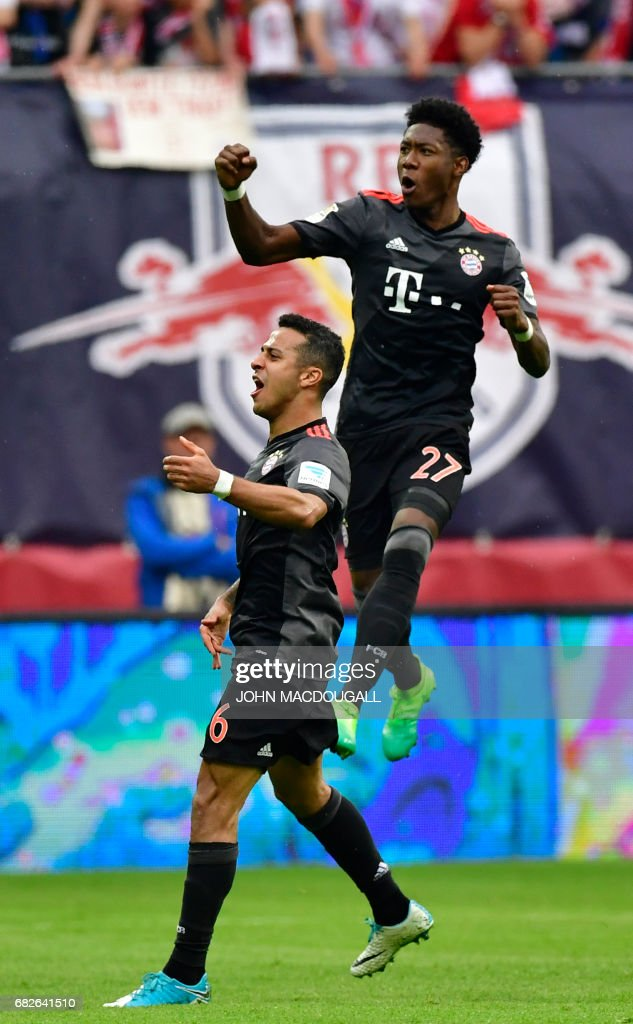 Bayern Munich's Austrian defender David Alaba (R) celebrates after scoring the 4-4 equalizer during the German first division Bundesliga football match between RB Leipzig and FC Bayern Munich on May 13, 2017 in Leipzig, eastern Germany. / AFP PHOTO / John