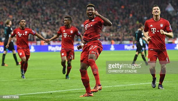 Bayern Munich's Austrian defender David Alaba celebrates afterscoring the third goal during the UEFA Champions League Group F secondleg football...
