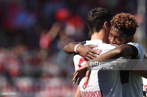 Bayern Munich's Austrian defender David Alaba embraces Bayern Munich's Polish striker Robert Lewandowski after the second goal for Munich during the...