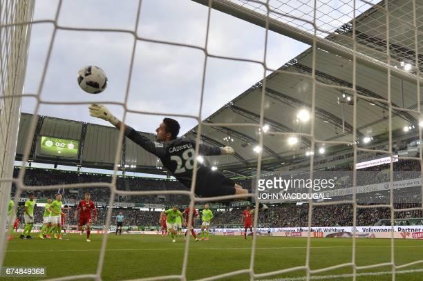 TOPSHOT Bayern Munich's Austrian defender David Alaba scores the 10 as Wolfsburg's Belgian goalkeeper Koen Casteels reaches for the ball during the...