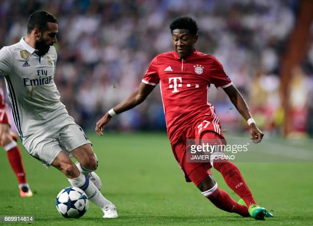 Bayern Munich's Austrian defender David Alaba vies with Real Madrid's defender Dani Carvajal during the UEFA Champions League quarterfinal second leg...
