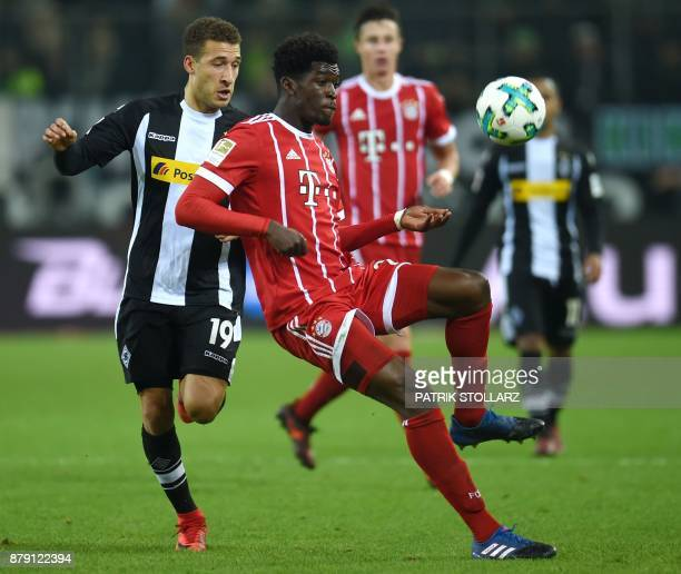 Bayern Munich's Austrian defender Marco Friedl and Moenchengladbach's US defender Fabian Johnson vie for the ball during the German First division...
