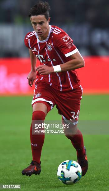Bayern Munich´s Austrian defender Marco Friedl runs with the ball during the German First division Bundesliga football match Borussia...