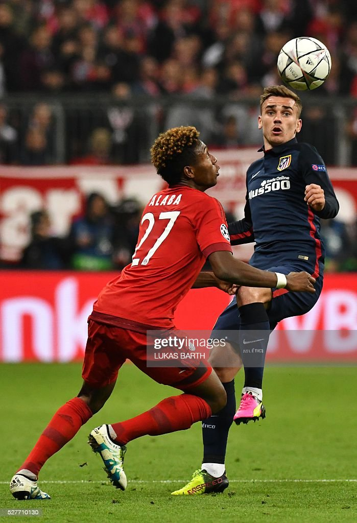 Bayern Munich's Austrian midfielder David Alaba (L) and Atletico Madrid's French forward Antoine Griezmann vie for the ball during the UEFA Champions League semi-final, second-leg football match between FC Bayern Munich and Atletico Madrid in Munich, southern Germany, on May 3, 2016. / AFP / LUKAS