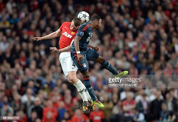 Bayern Munich's Austrian midfielder David Alaba and Manchester United's English defender Phil Jones during the UEFA Champions League quarterfinal...