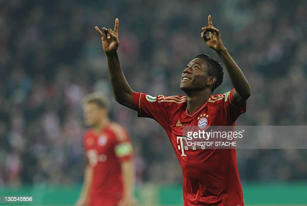 Bayern Munich's Austrian midfielder David Alaba celebrates after scoring the 20 during the German Football League DFB Cup second round match between...