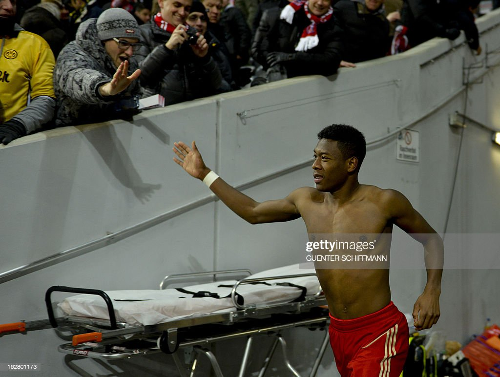 Bayern Munich's Austrian midfielder David Alaba celebrates with fans after the German Cup quarter-final football match FC Bayern Munich vs Borussia Dortmund in Munich, southern Germany, on February 27, 2013. Bayern Munich won the match 1-0. AFP PHOTO / GUENTER SCHIFFMANN DURING THE MATCH AND PROHIBITS MOBILE (MMS) USE DURING AND FOR FURTHER TWO HOURS AFTER THE MATCH. FOR MORE INFORMATION CONTACT DFL.