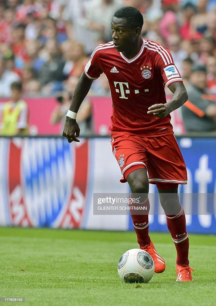 Bayern Munich's Austrian midfielder David Alaba plays the ball during the German first division Bundesliga football match FC Bayern Munich vs FC Nuremberg in Munich, southern Germany on August 24, 2013. Bayern Munich won the match 2-0.