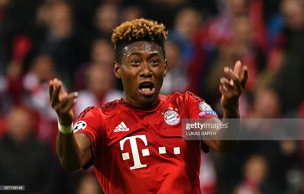 Bayern Munich's Austrian midfielder David Alaba reacts during the UEFA Champions League semi-final, second-leg football match between FC Bayern Munich and Atletico Madrid in Munich, southern Germany, on May 3, 2016. / AFP / LUKAS