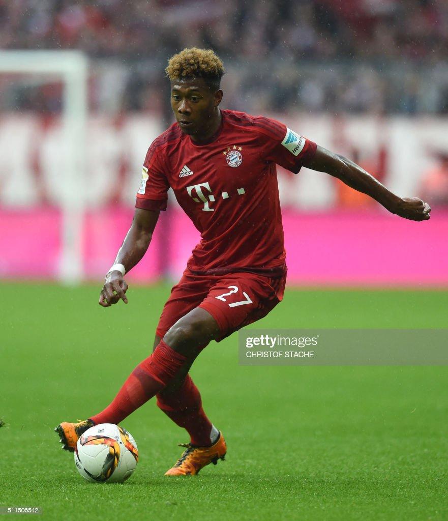 Bayern Munich s Austrian midfielder David Alaba runs with the ball