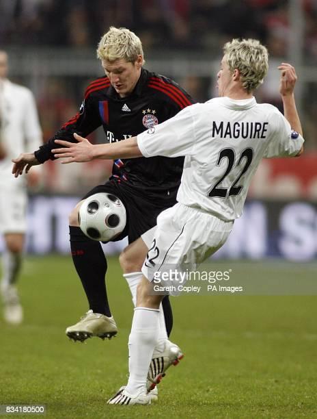 Bayern Munich's Bastian Schweinsteiger and Aberdeen's Christopher Maguire battle for the ball