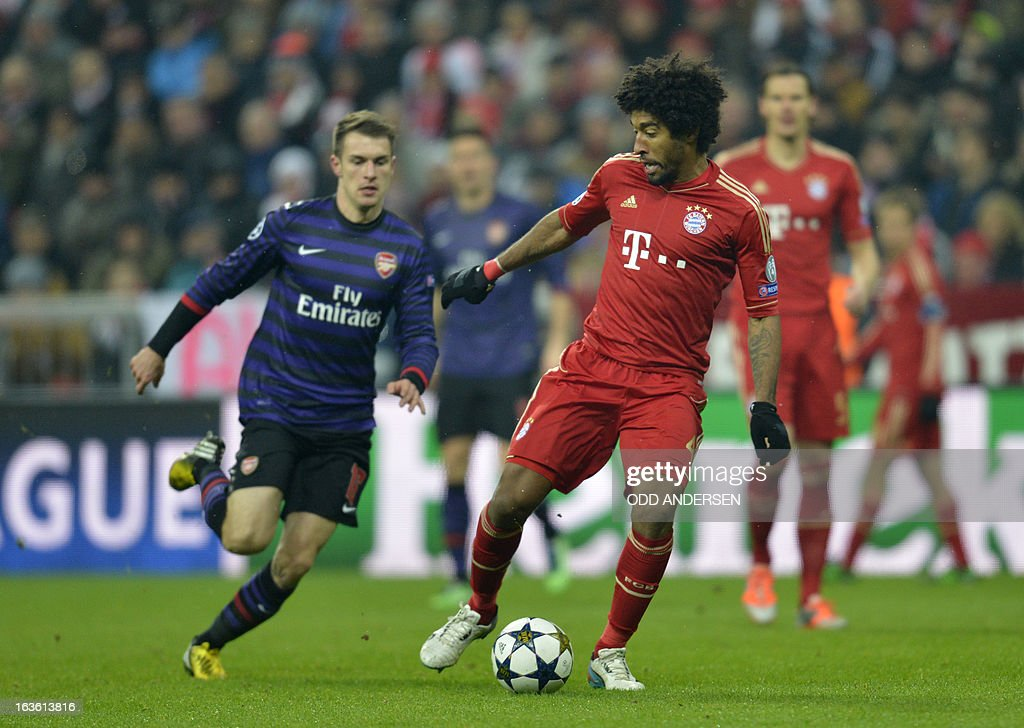 Bayern Munich's Brazilian defender Dante (R) and Arsenal´s Welsh midfielder Aaron Ramsey vie for the ball during the UEFA Champions League Round of 16 second-leg football match FC Bayern Munich vs FC Arsenal London in Munich, southern Germany, on March 13, 2013.