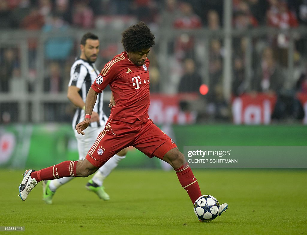 Bayern Munich's Brazilian defender Dante plays the ball during the UEFA Champions League quarter final match between FC Bayern Munich vs Juventus Turin at the Allianz Arena stadium in Munich, southern Germany, on April 2, 2013.