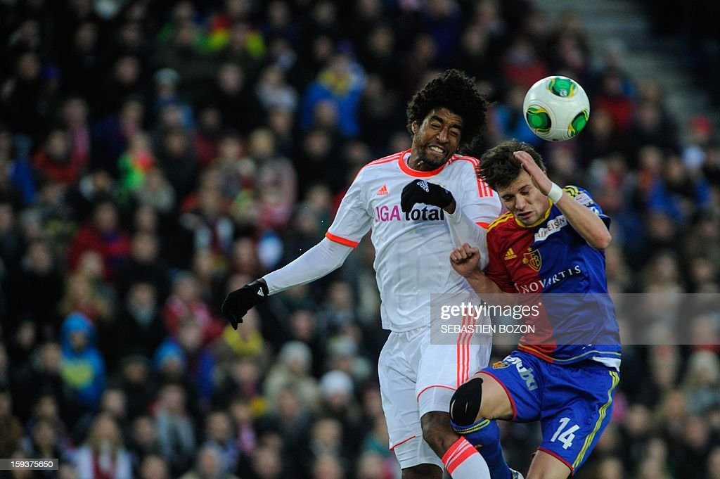 Bayern Munich's Brazilian defender Dante (C) vies with Basel's Swiss midfielder Valentin Stocker during a friendly football match betwwn Basel (FCB) and Bayern Munich (FCBM) in Basel on January 12, 2013. AFP PHOTO / SEBASTIEN BOZON