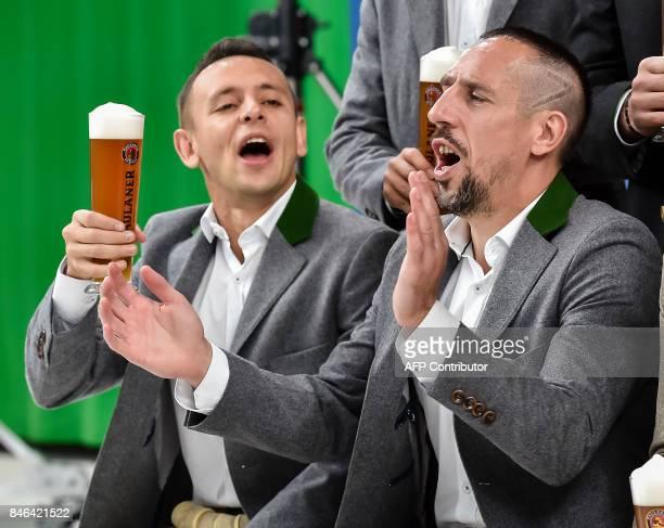 Bayern Munich's Brazilian defender Rafinha and Bayern Munich's French midfielder Franck Ribery attend a photo shooting for a FC Bayern Munich sponsor...