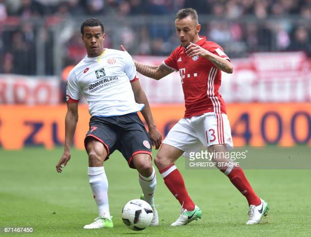 Bayern Munich's Brazilian defender Rafinha and Mainz' Swedish midfielder Robin Quaison vie for the ball during the German First division Bundesliga...